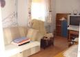 Duży pokój w apartamencie wędkarskim.